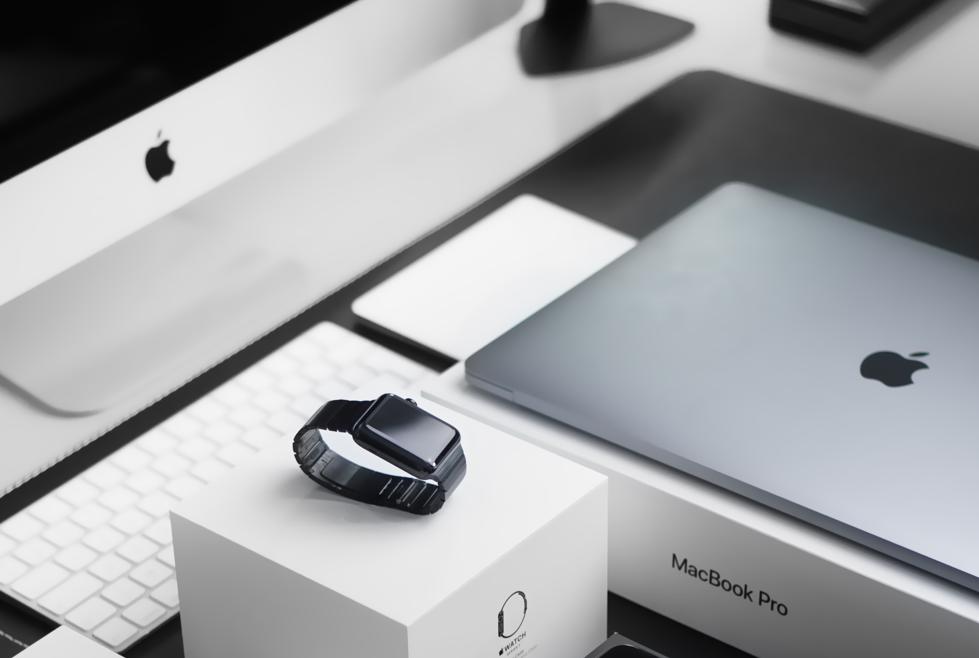 Apple laptop and imac on desk