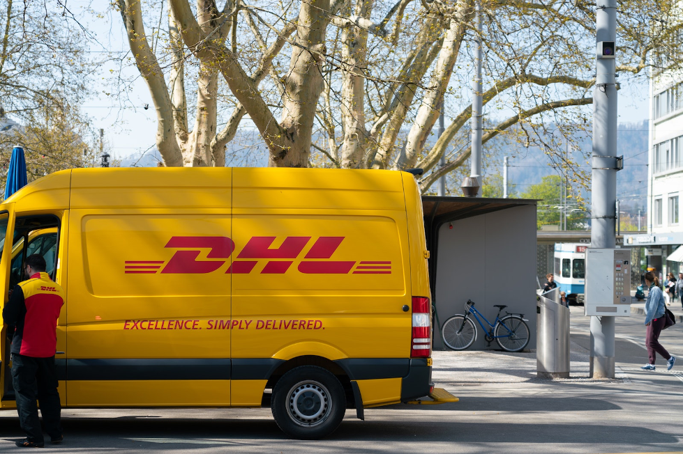 DHL delivery truck parked on a road