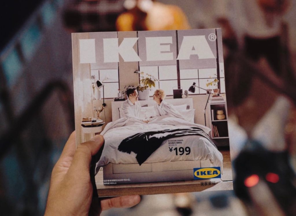 Person holding IKEA catalogue